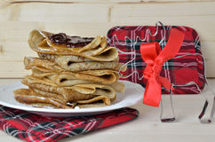 Pancakes and Christmas tartan decoration Stock Photography