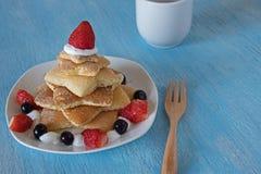 Pancakes christmas tree with strawberry Royalty Free Stock Photo