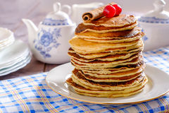 Pancakes. With cinamon and cowberries Stock Image