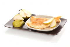 Pancakes with cinnamon and pears. Royalty Free Stock Photos