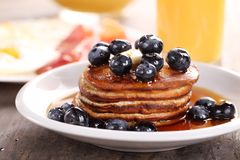 Pancakes. Close up of plate with pancakes, juice and eggs with bacon royalty free stock photos