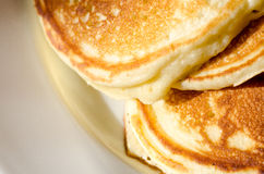 Pancakes. Close up view of freshly cooked pancakes on a white plate Royalty Free Stock Images