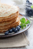 Pancakes. Close up view of nice yummy crepes with berry on table stock photos