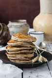 Pancakes with coconut milk and bananas Stock Photos