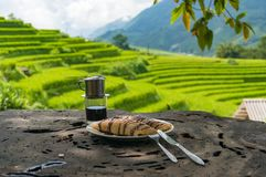 Pancakes and coffee with rice paddy view on the background. Pancakes and coffee on wooden table with rice terraces, paddy view on the background Stock Photo