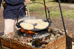Pancakes cooking on the fire Royalty Free Stock Photos