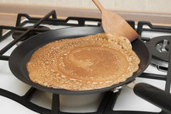 Pancakes cooking Royalty Free Stock Images