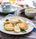 Pancakes from cottage cheese  with banana, powdered sugar and mi Royalty Free Stock Photo