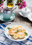 Pancakes from cottage cheese  with banana, powdered sugar, selec. Pancakes from cottage cheese  with banana, powdered sugar and fresh mint, gray wooden Stock Images