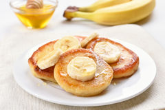 Pancakes with cottage cheese and banana slices Stock Photos