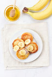Pancakes with cottage cheese and banana slices Stock Images