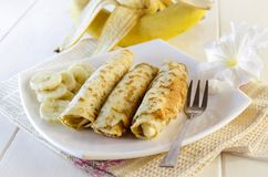 Pancakes with cottage cheese and banana. Pancakes with cottage cheese and a banana on a white plate Royalty Free Stock Photo