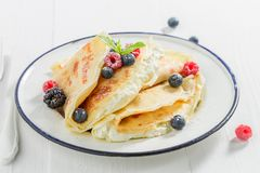 Pancakes with cottage cheese, berries and powder sugar. On white background Stock Photography