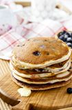 Pancakes with cottage cheese and blueberries. On a wooden tray Stock Image