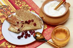 Pancakes for cottage cheese and cranberry . Pancakes for cottage cheese and cranberry , honey a glass jar Stock Photography