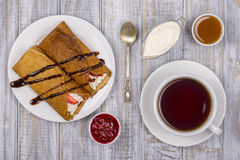 Pancakes with cottage cheese and cup green tea on the wooden table Stock Photography