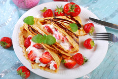Pancakes with cottage cheese and fresh strawberries Stock Photo