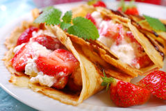 Pancakes with cottage cheese and fresh strawberries Stock Images