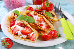 Pancakes with cottage cheese and fresh strawberries Royalty Free Stock Image