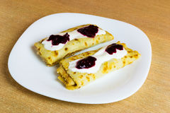 Pancakes with cottage cheese, fruit jam and cream. Royalty Free Stock Photo