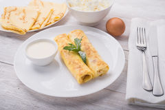 Pancakes with cottage cheese. And gren mint on white plate background Stock Photography