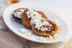 Pancakes with cottage cheese and honey. Homemade gluten free pancakes with cottage cheese and honey served on oval plate Royalty Free Stock Images
