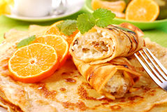 Pancakes with with cottage cheese and orange. Pancakes with cottage cheese and orange poured chocolate Royalty Free Stock Image