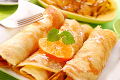 Pancakes  with cottage cheese and orange. Three rolled pancakes with cottage cheese and orange Royalty Free Stock Photography