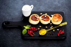Pancakes with cottage cheese. Berries and nuts. Fitness food Stock Photos