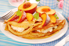 Pancakes with cottage cheese and peach. Delicious pancakes with cottage cheese and fresh peach Stock Photo