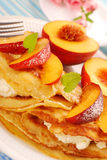 Pancakes with cottage cheese and peach stock photo