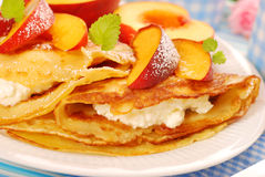 Pancakes with cottage cheese and peach Stock Images