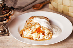 Pancakes with cottage cheese and sour cream honey food. Pancakes with cottage cheese and sour cream with honey food in beautiful rural village still life Stock Photos