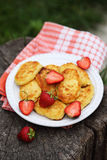 Pancakes from cottage cheese. With strawberries Stock Photo
