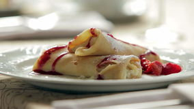 Pancakes with cottage cheese and strawberries stock video