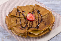 Pancakes with cottage cheese, strawberry, chocolate and on the wooden table Stock Photos