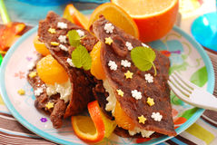 Pancakes with cottage cheese and tangerines. Chocolate pancakes with cottage cheese,tangerines and star shape sprinkles as dessert for child Stock Photography