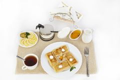 Pancakes with cottage cheese for tea with honey, sour cream and lemon. stock image