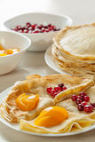 Pancakes with cranberies and peaches served Stock Photos