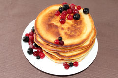Pancakes with cranberries and black currants Stock Images