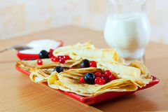 Pancakes with cranberries and blueberries Royalty Free Stock Image