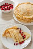 Pancakes with cranberries served Stock Images
