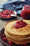 Pancakes with cranberry jam Stock Photography