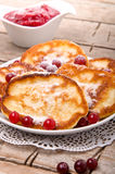 Pancakes with cranberry sauce Royalty Free Stock Photos