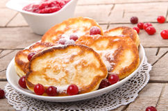 Pancakes with cranberry sauce Stock Photos