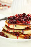 Pancakes and Cranberry Syrup Stock Images