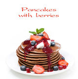 Pancakes with cream and berries, close-up, isolated. On white royalty free stock images