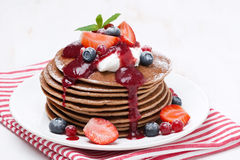 Pancakes with cream and berries on a white wooden table. Close-up stock images