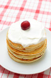 Pancakes with cream and cherries Royalty Free Stock Photos