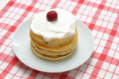 Pancakes with cream and cherries Royalty Free Stock Images